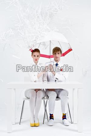 shredded paper raining down on businesspeople
