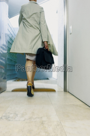 businesswoman leaving the office
