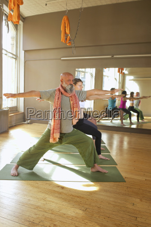 people doing warrior pose in yoga