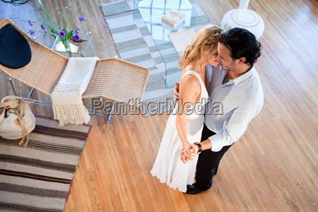couple dancing at home high angle
