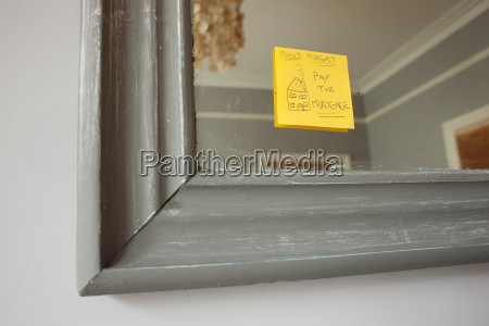 adhesive note on mirror saying dont