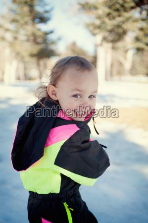 girl in snow looking over shoulder