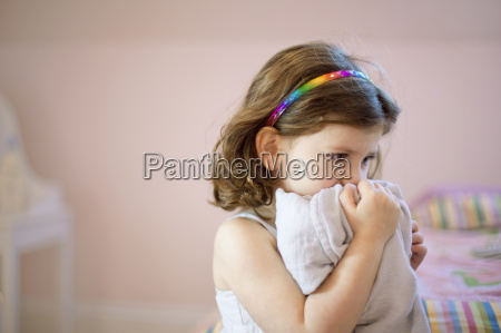 unhappy three year old girl in