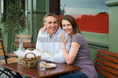 smilling mature couple at lunch