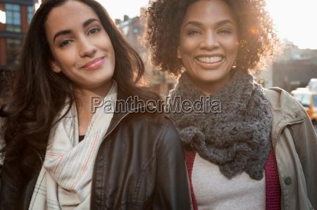 smiling women on city street