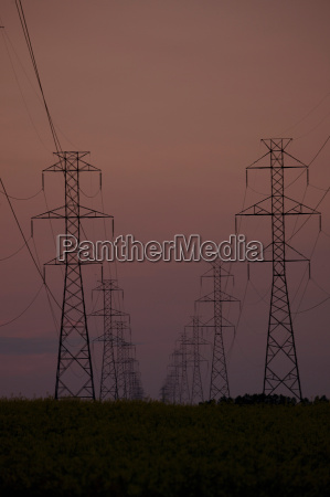 silhouette of electrical towers at sunset