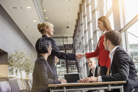 businesswoman and team meeting client
