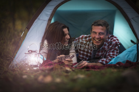 mature couple lying together in tent