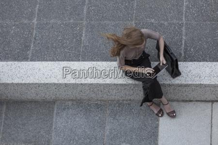 high angle view of woman using