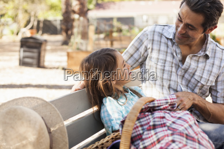 mid adult man talking with daughter