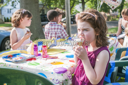 young girl eating ice cream at