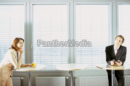 businessman and businesswoman at office bar