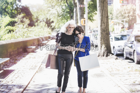 young woman and her mentor shopping