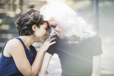 young woman sharing tender moment with