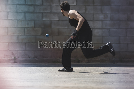 young male handball player running for