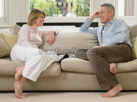 mature couple resting on a sofa