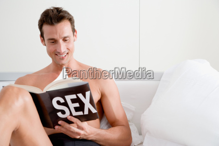 man reading a book about sex