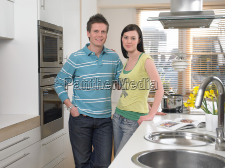 young couple standing in kitchen