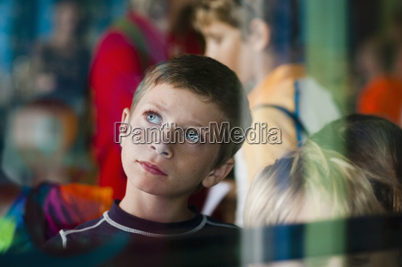 view through glass of young boy