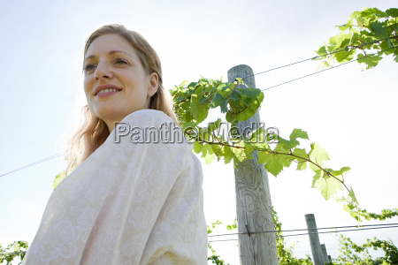 mid adult woman in vineyard with