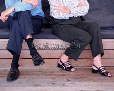 mature couple sitting next to each