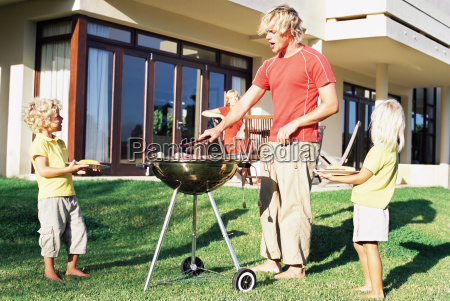 father doing a barbecue for his