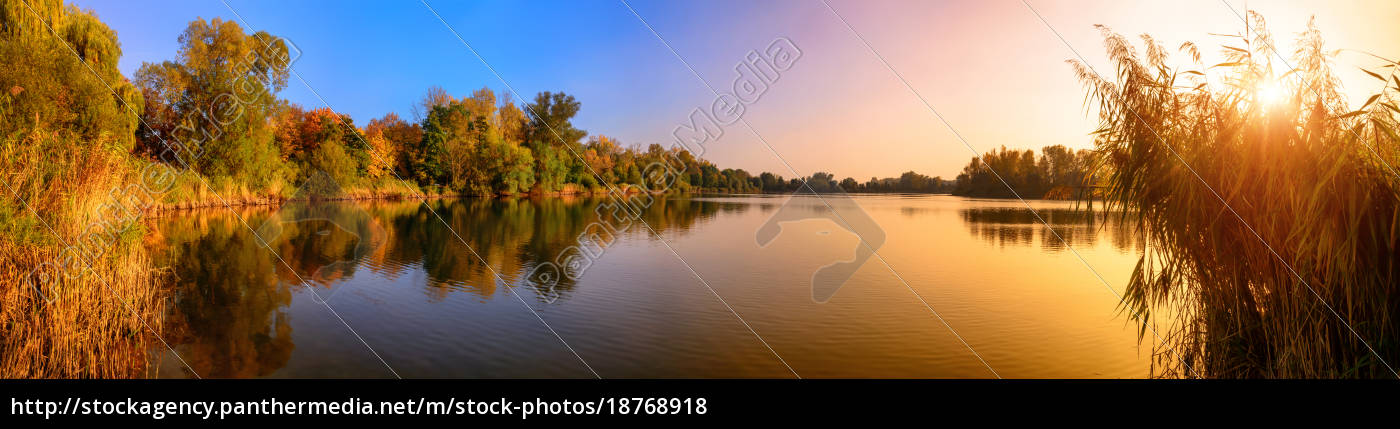 sunset, on, a, lake, a, panorama, in - 18768918