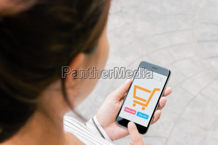 close up woman use phone shopping