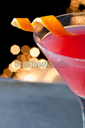 cosmopolitan cocktail with twist of orange