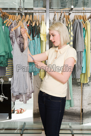 woman shocked at clothes price