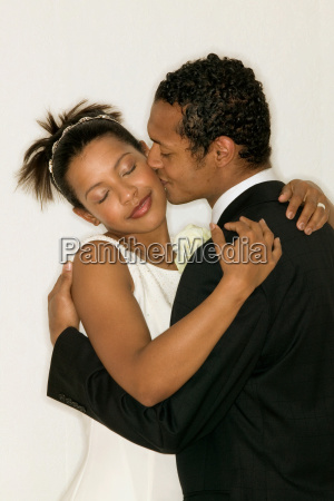 newlywed couple kissing