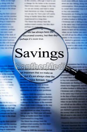 word savings under magnifying glass