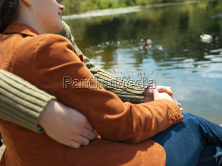 couple sitting near lake