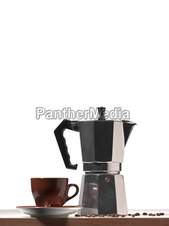 a french press and coffee cup