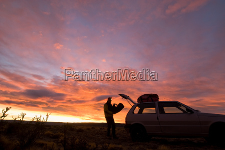 silhouette of a man putting a
