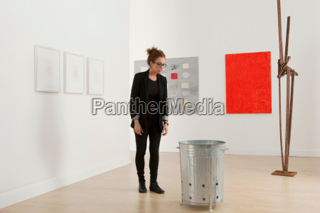 young woman looking at artwork in