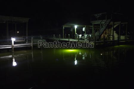 pier at night poquito bayou emerald