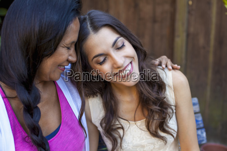 mother and daughter sharing tender moment