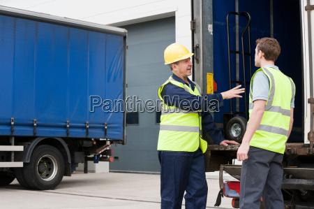 two men loading truck