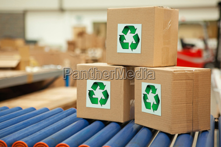cardboard boxes with recycling symbols on