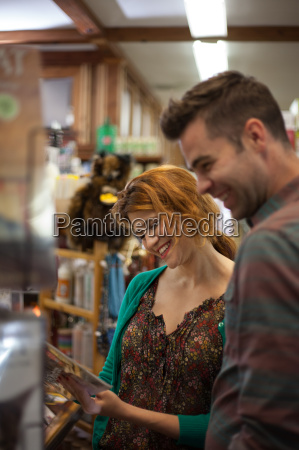 man and woman shopping in health