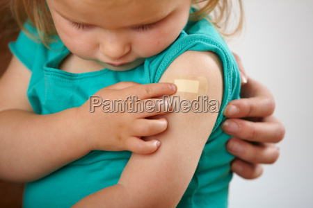 little girl looking at plaster where
