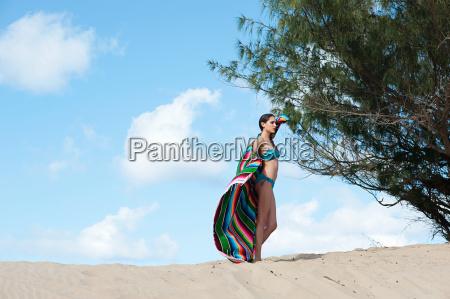 woman standing on sand dune