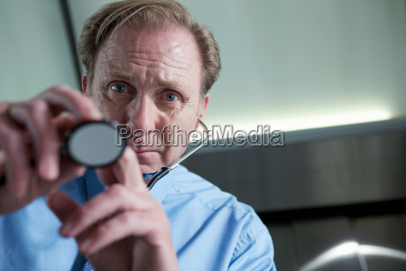 doctor using stethoscope personal perspective
