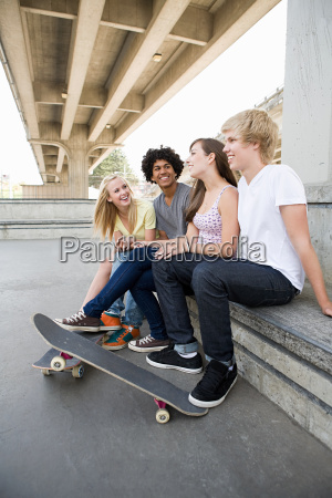 teenage friends with skateboards