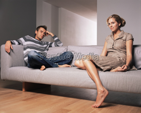 young couple sitting on a sofa