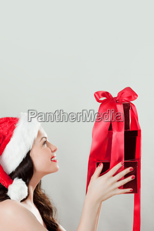 young brunette woman wearing santa hat