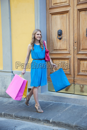 young woman on street with shopping