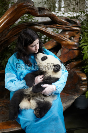 woman holding 6 month old giant