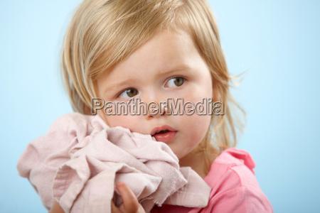 girl holding comfort blanket
